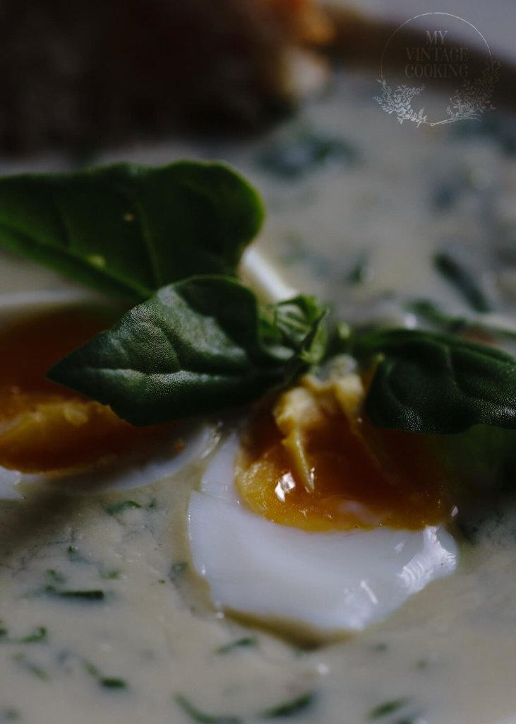 creay spinach soup served with boiled eggs