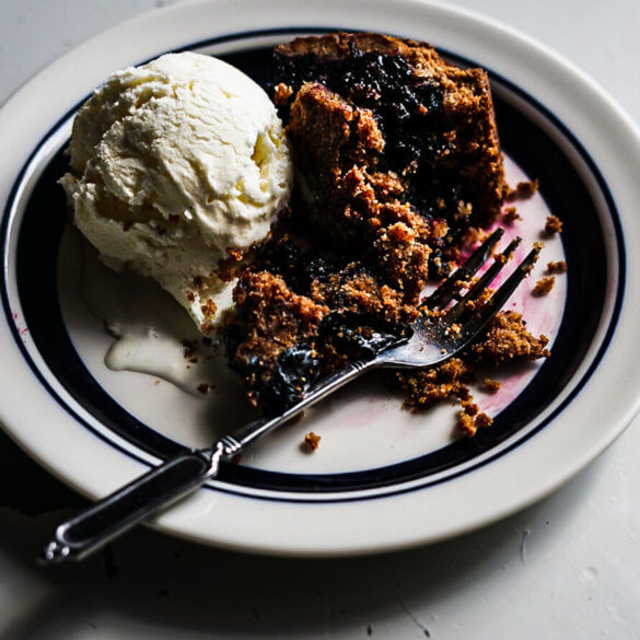 A warm dessert made with rye and wild bilberries and served with vanilla ice cream