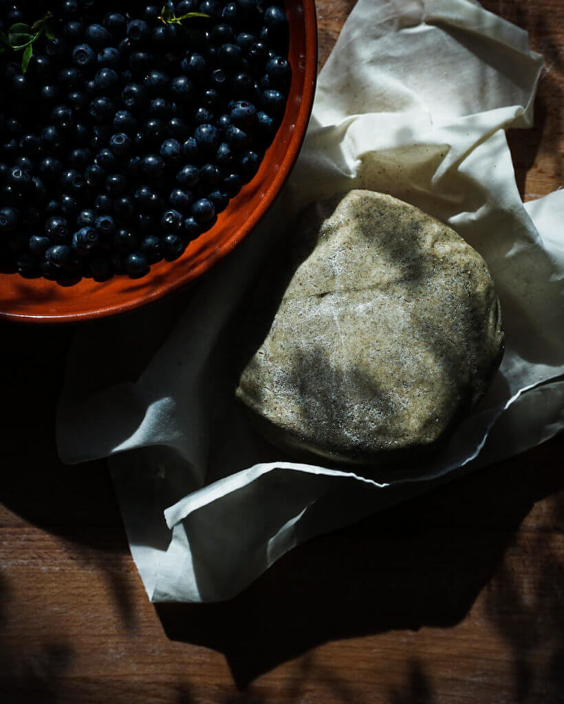 Wild blueberries aka bilberries and a piece of rye dough